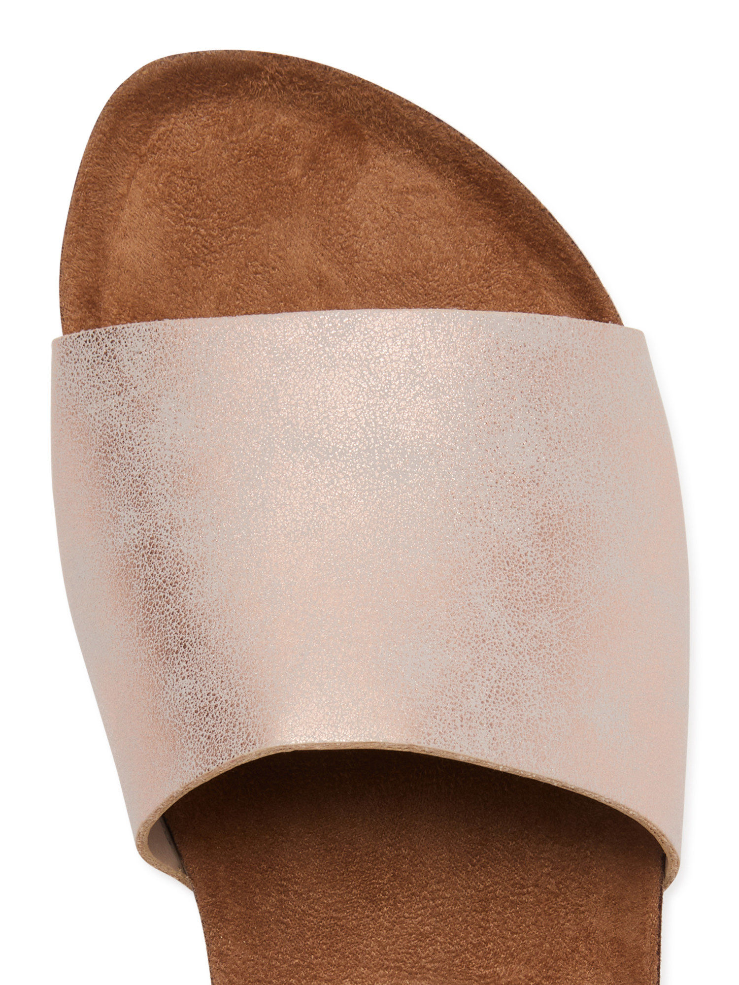 A top-down view of a rose gold slide sandal