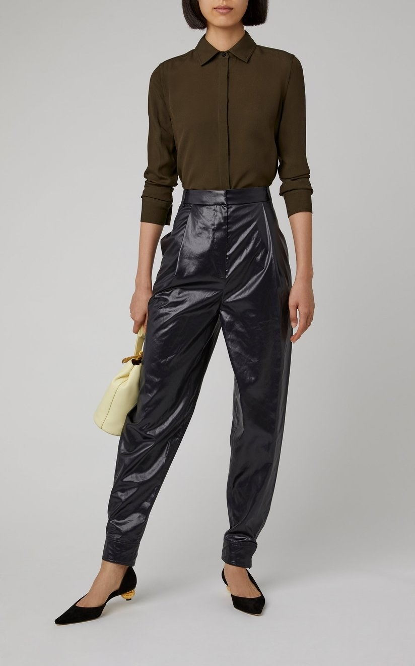 A model wearing the Tibi pleated shell tapered pants.
