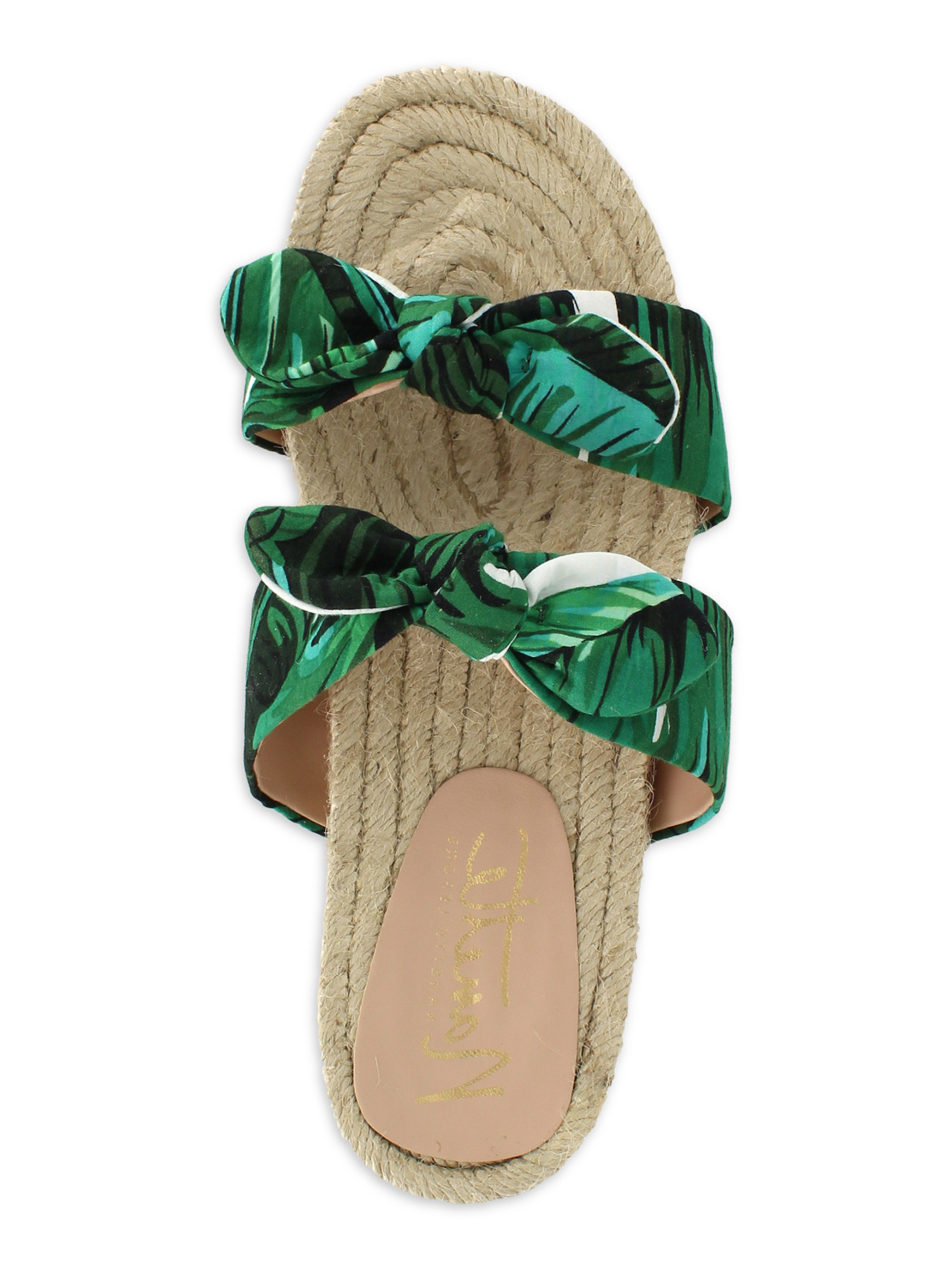 A sandal with a green palm print and a flat woven espadrille sole