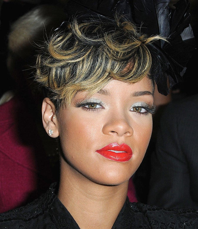 Rihanna has a short hairstyle with bright highlights