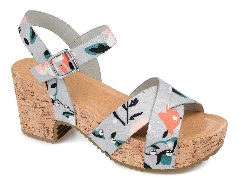 A floral print platform crossover strap sandal