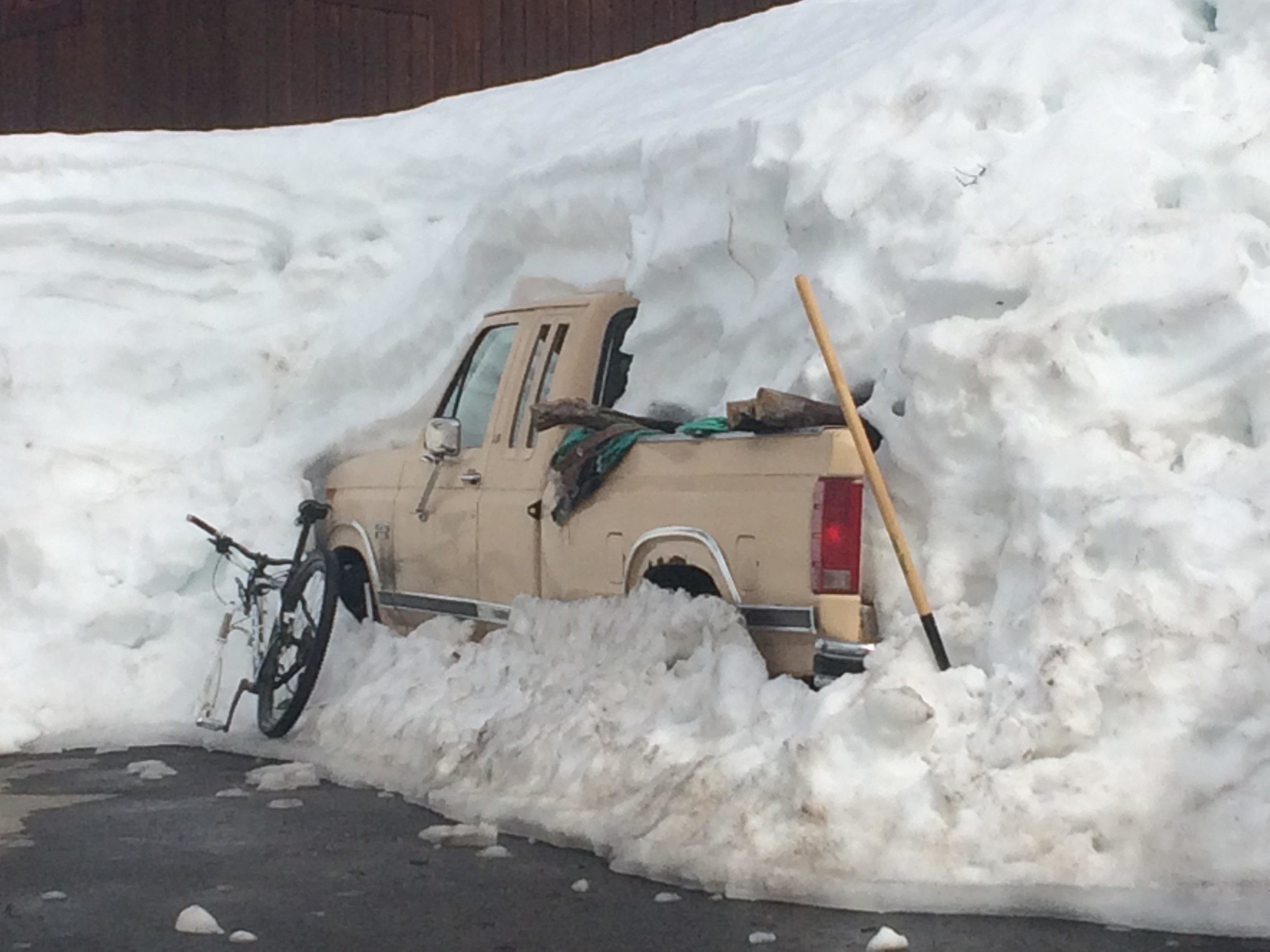 A truck buried deep in snow.