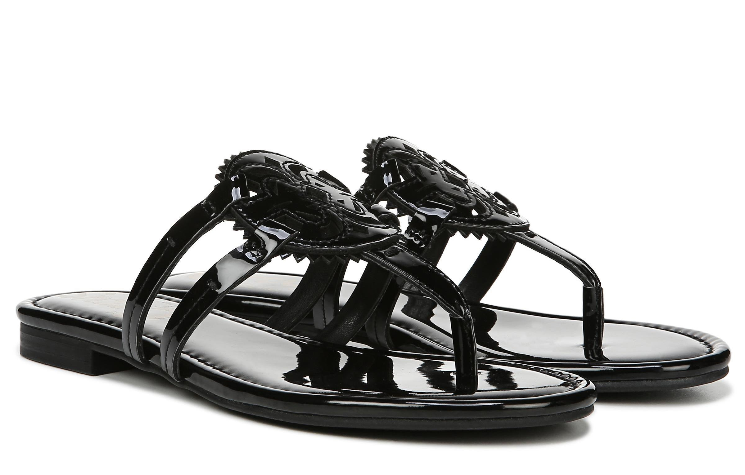 A pair of shiny black sandals