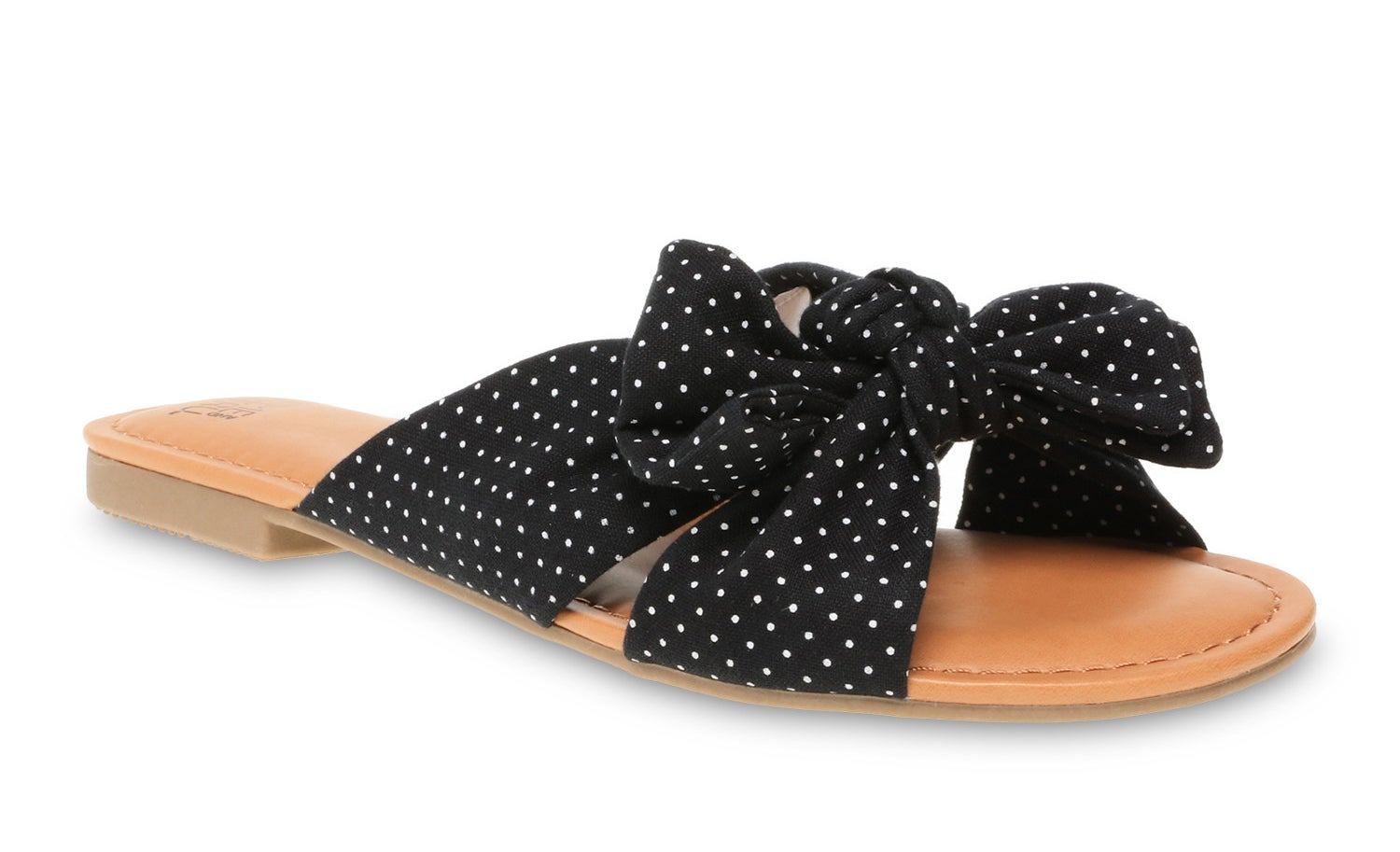 A black and white polka dot bow slide sandal