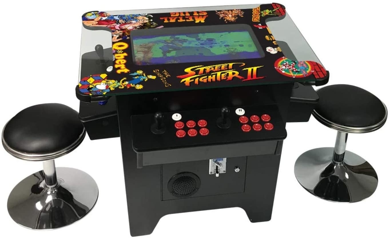 A black arcade table for Street Fighter 2 and several other games, flanked by two matching stools.