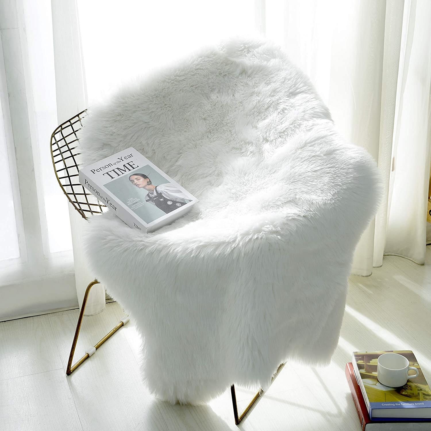 A faux fur rug draped over a wire chair