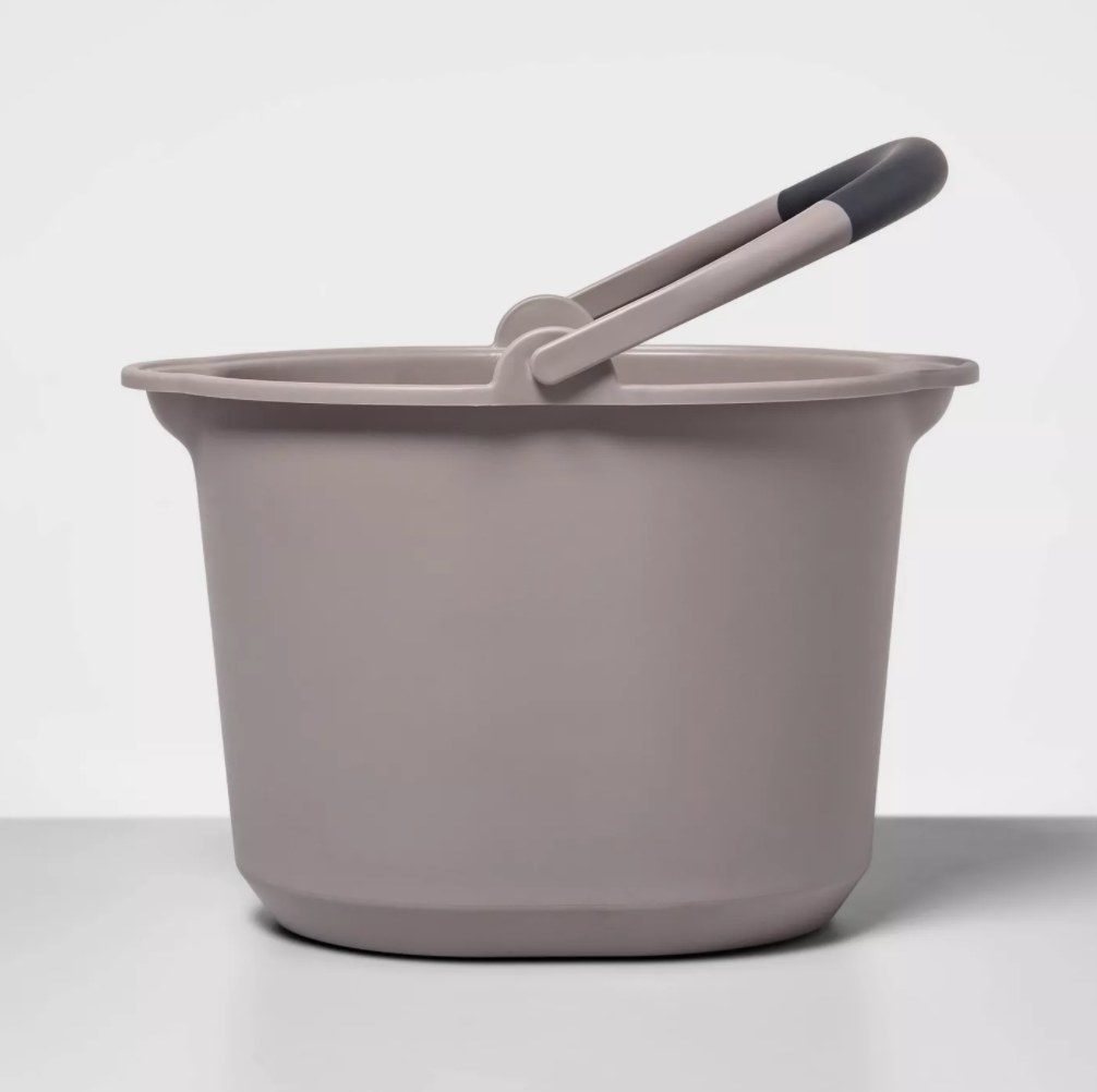 The round plastic bucket with handle