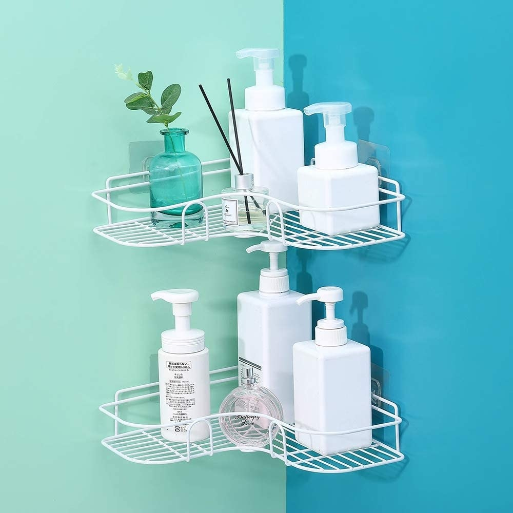 Two of the shelves perched neatly on top of each other in a shower
