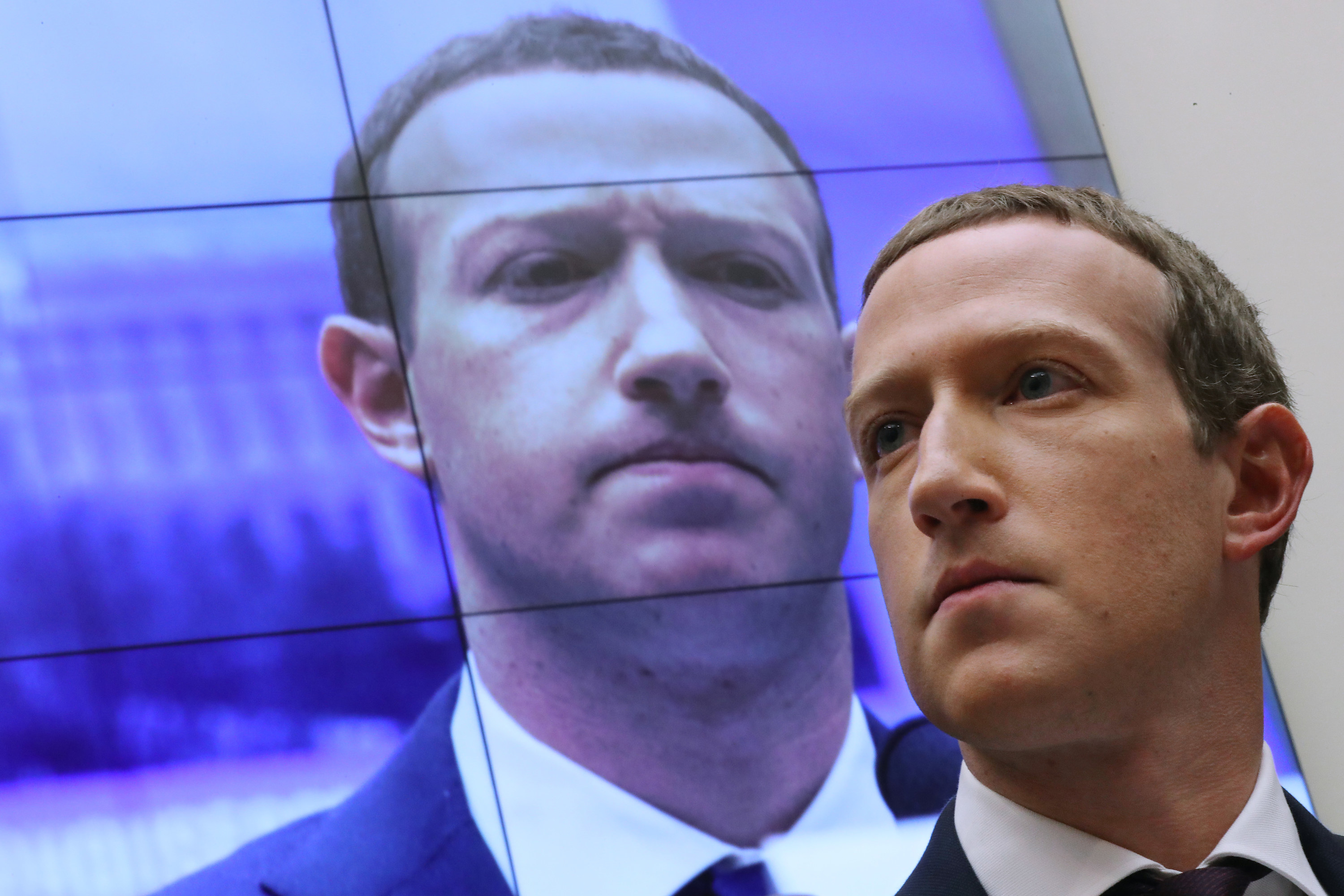 An image of Mark Zuckerberg is seen behind Mark Zuckerberg