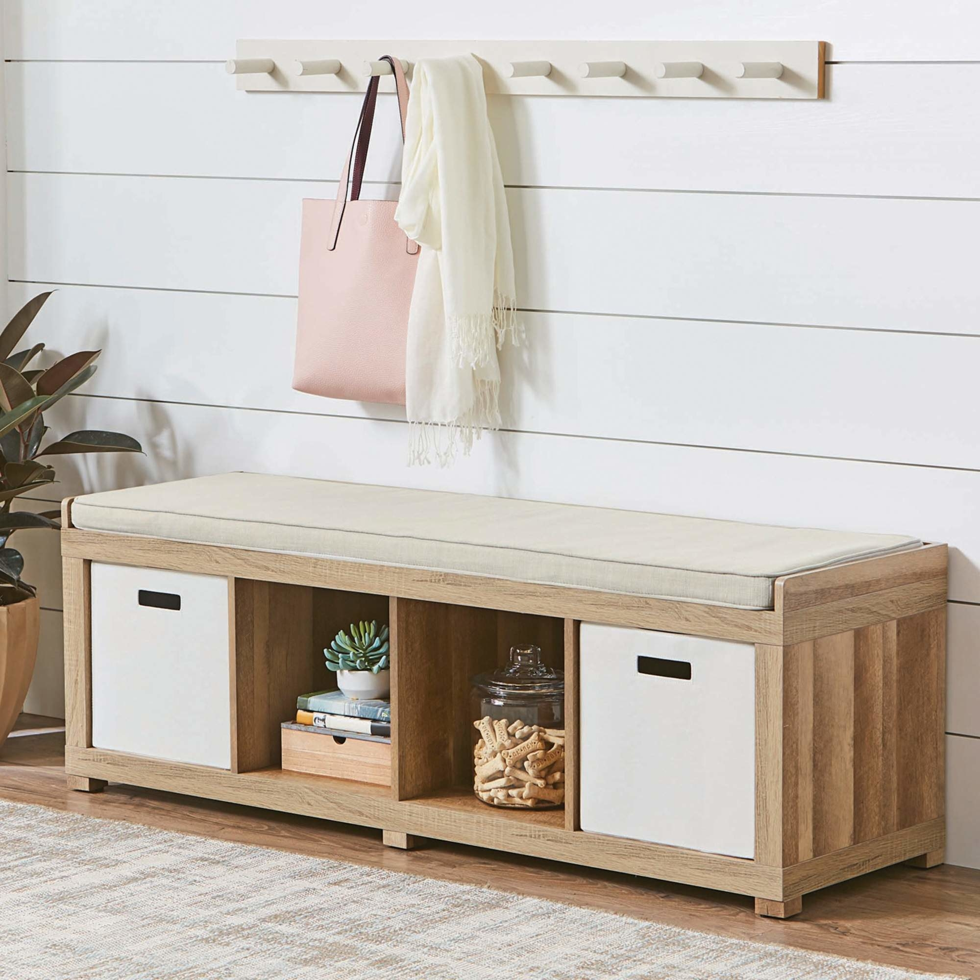 A beige storage bench with four holes for storing items