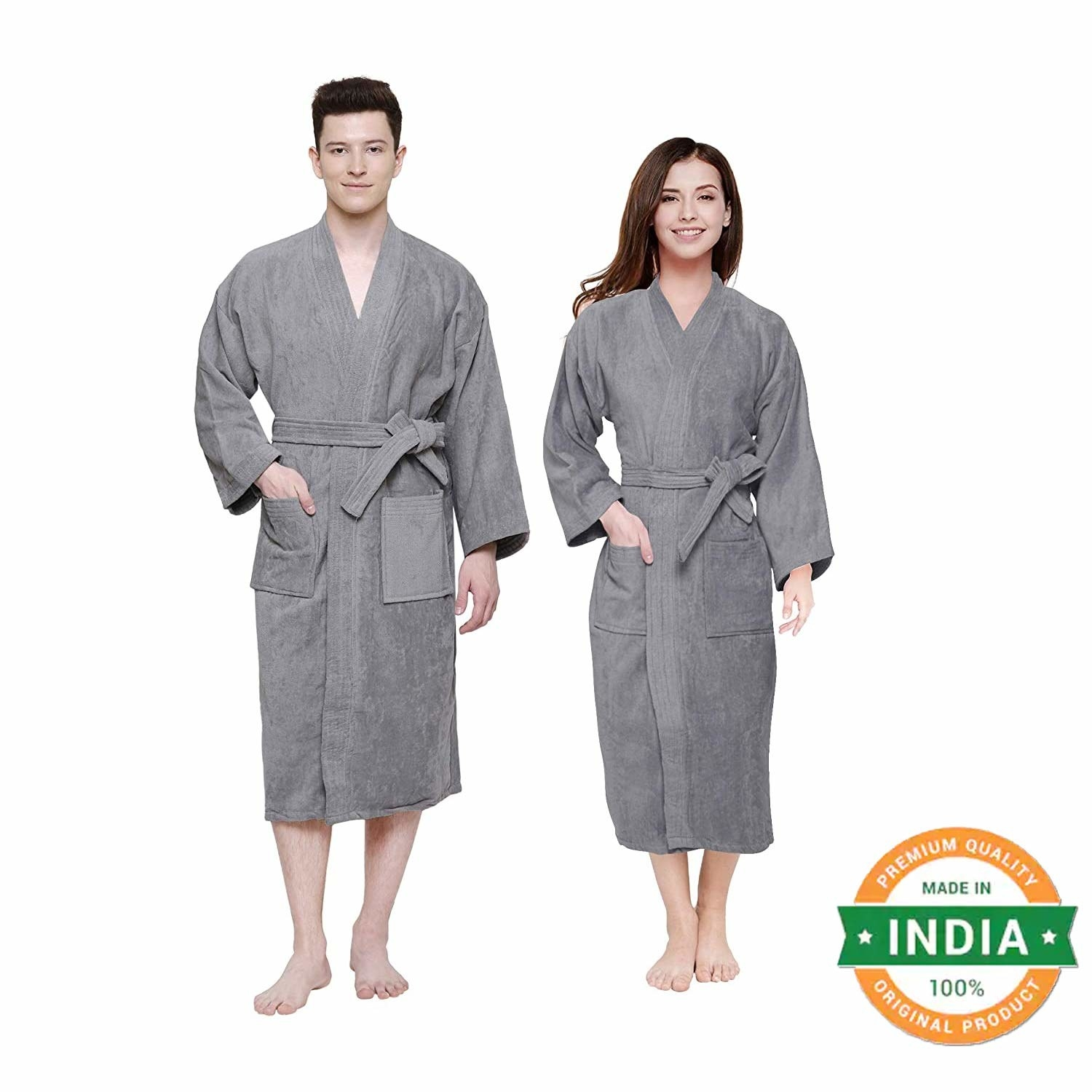 A man and a woman wearing grey unisex bathrobes