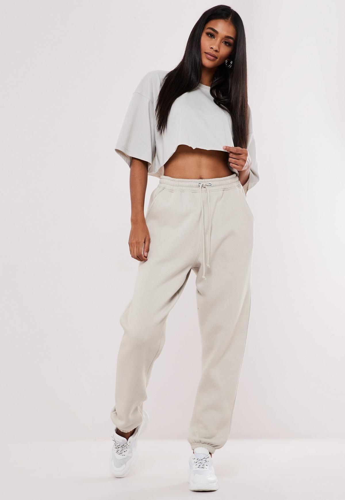 a model wearing oversized tan sweats