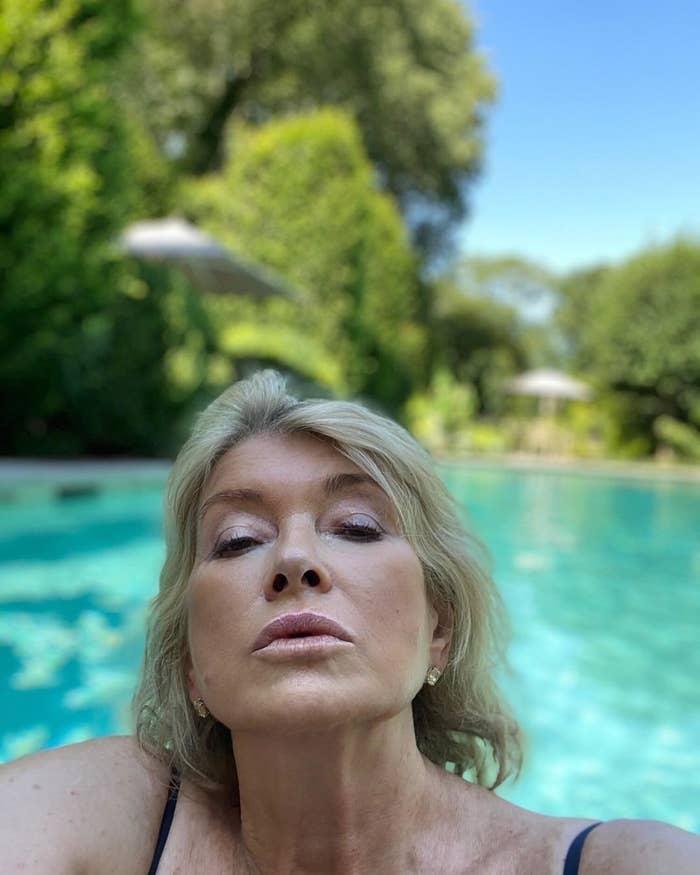 Martha Stewart taking a selfie in a pool