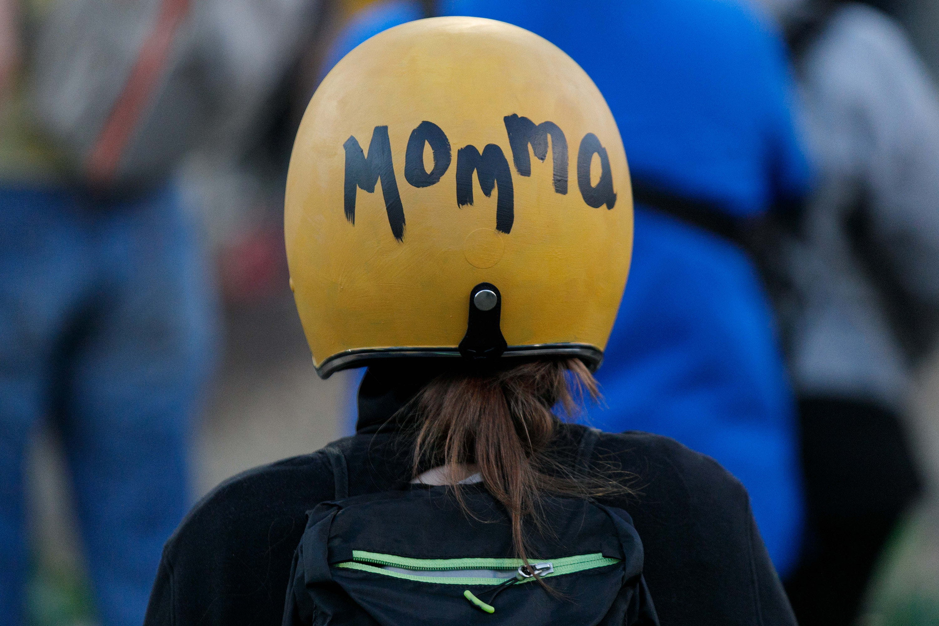 "A woman wearing a helmet that says ""Momma"" at the demonstrations in Portland"