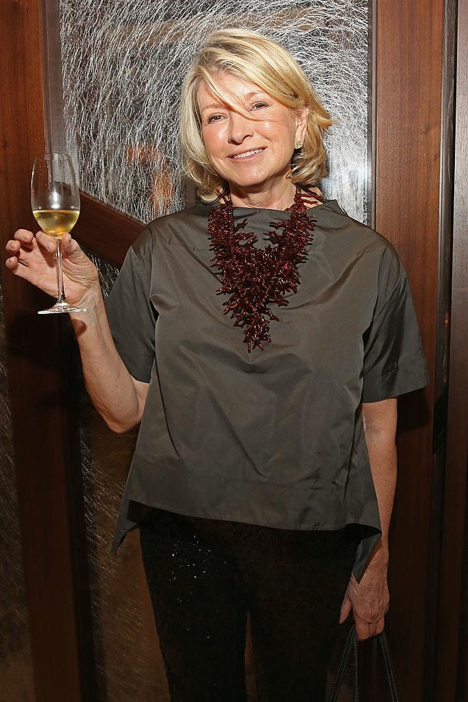Martha Stewart raising a wine glass
