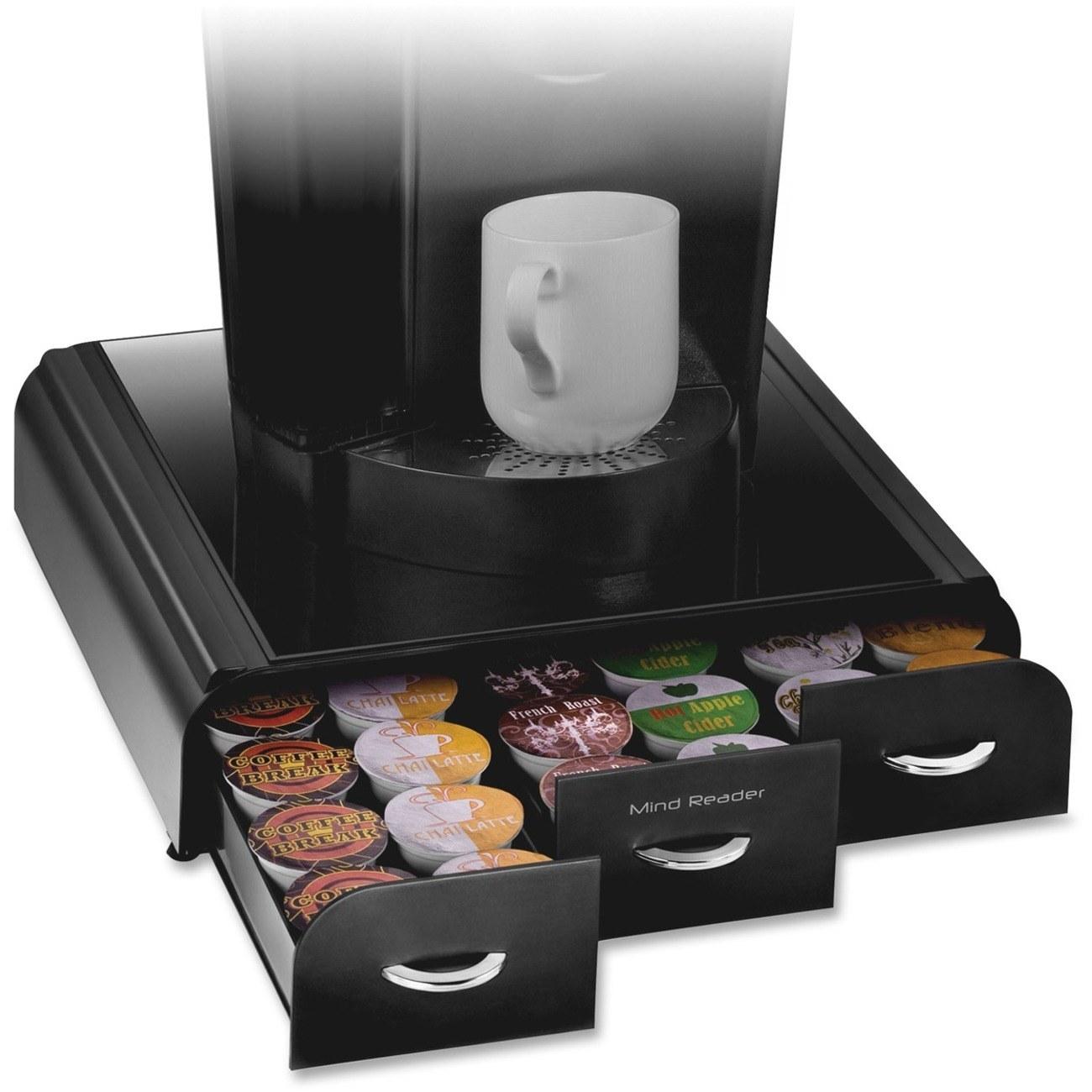 A slide out pod drawer full of pods under a Keurig machine