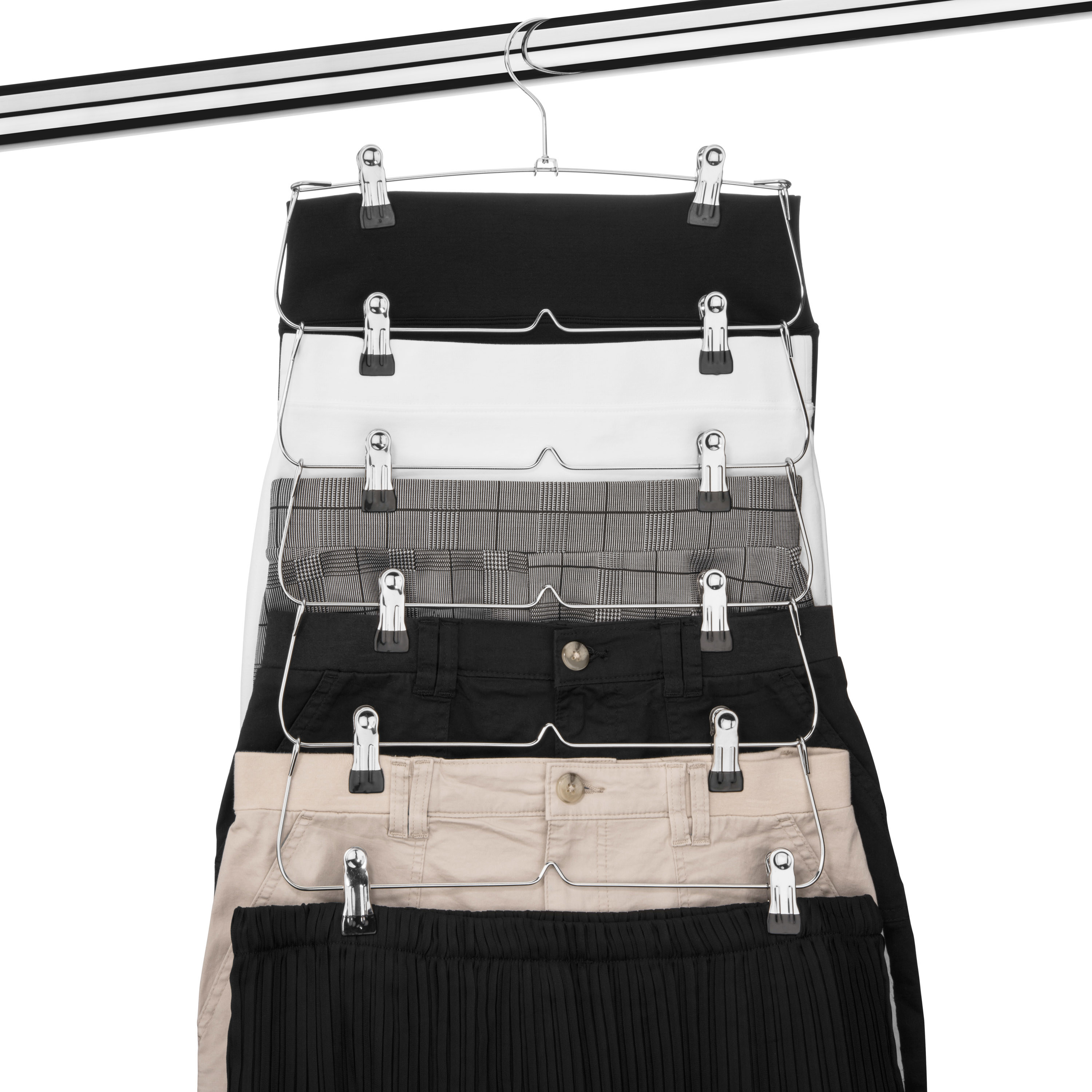 A tiered hanger with five pairs of pants on it