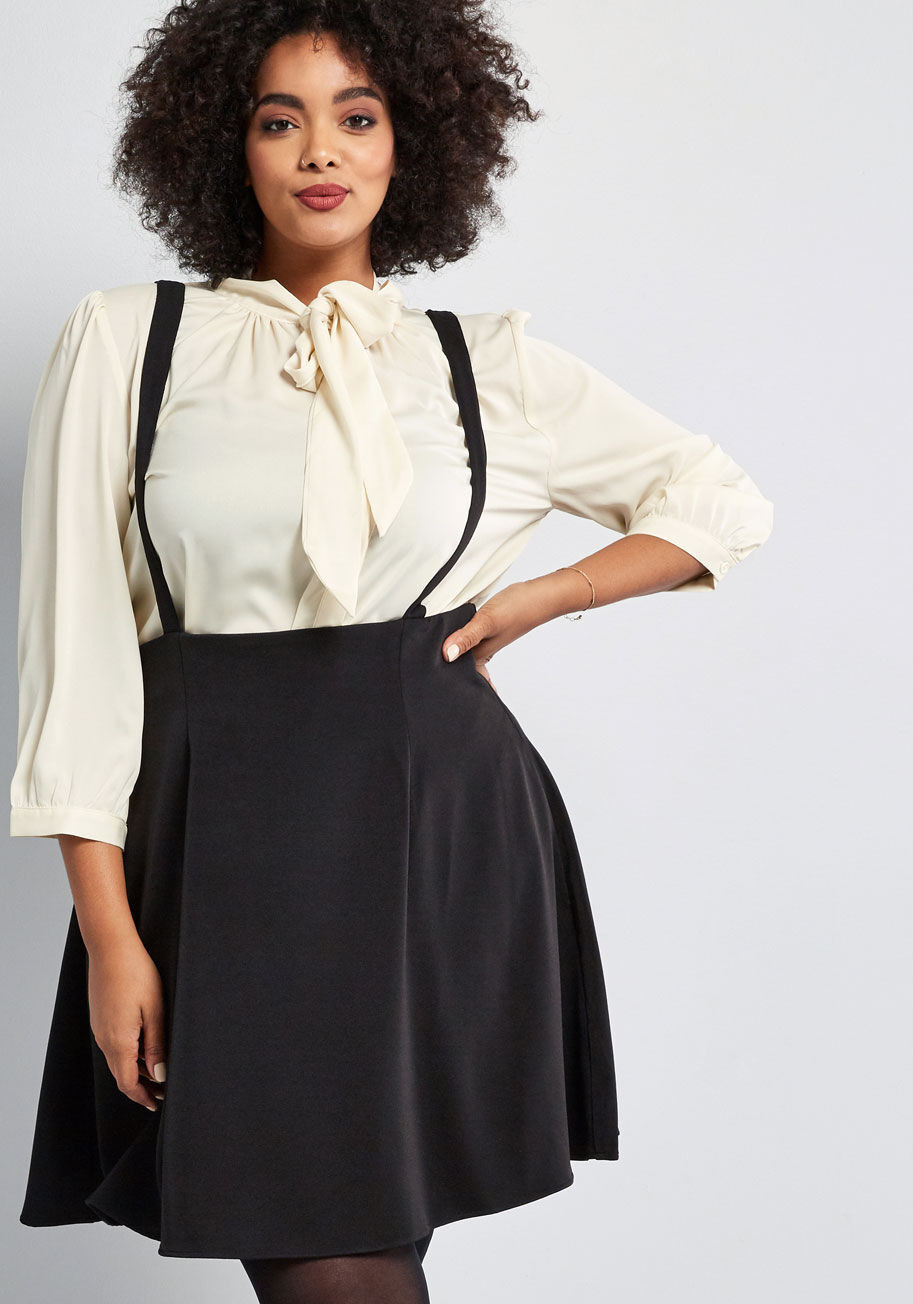 Model wearing the black dress with a white blouse