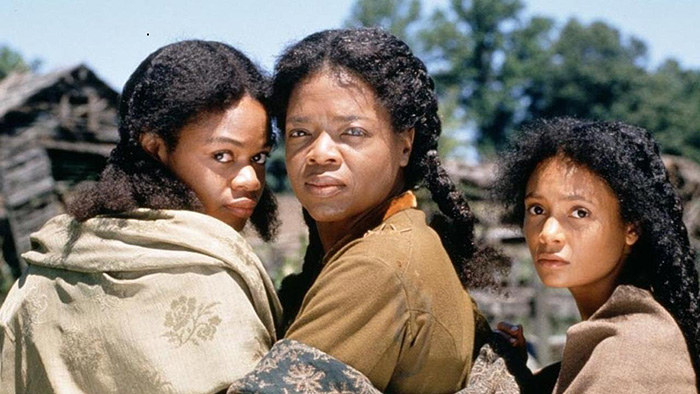 Oprah Winfrey poses with Thandie Newton and Kimberly Elise on the set of Beloved, the 1998 film