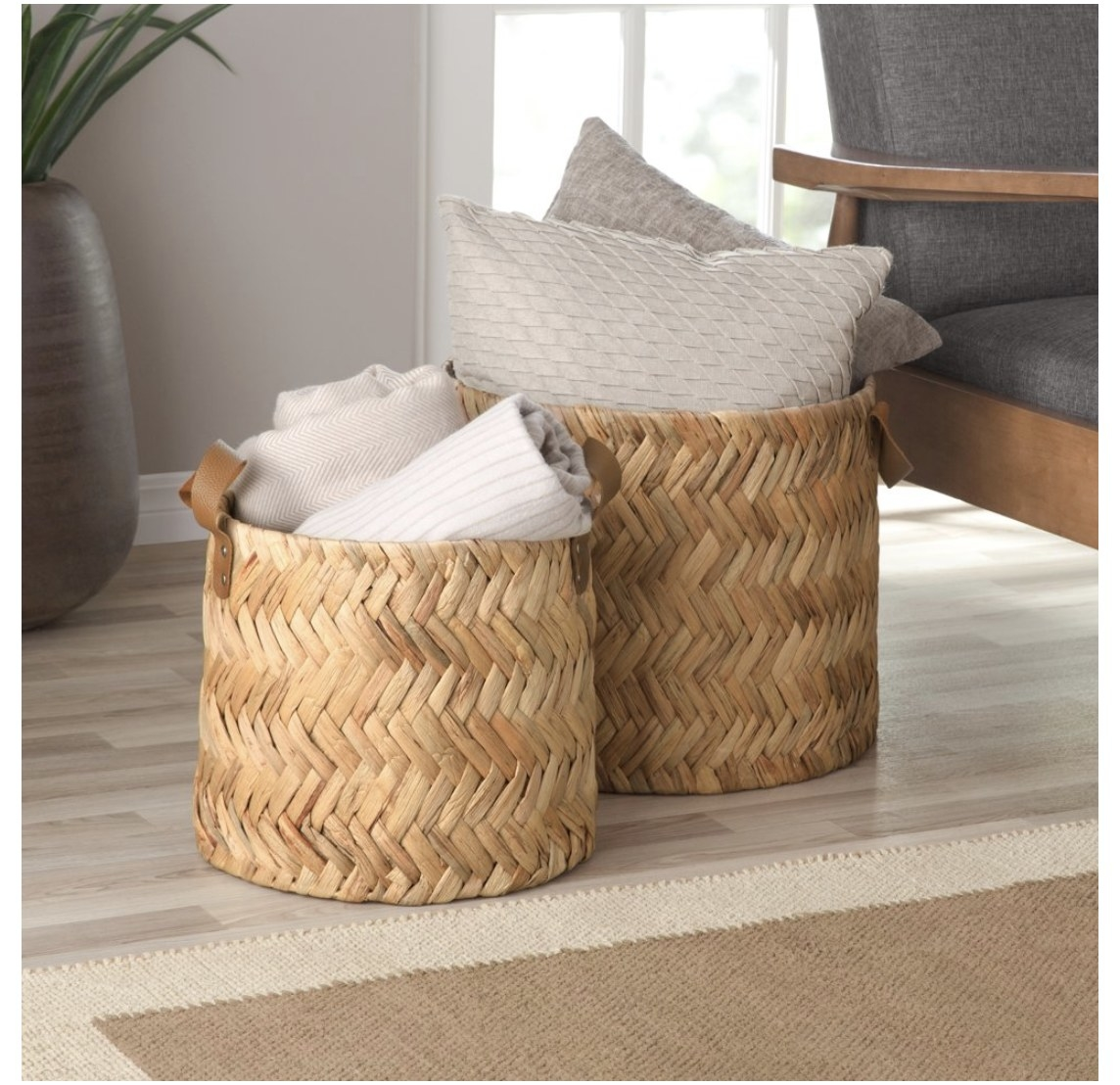 Two straw herringbone baskets in different sizes