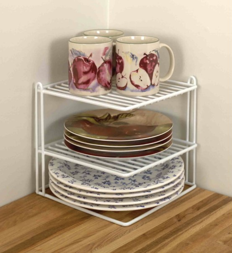 A white tree shelfed organizer with dishes on it