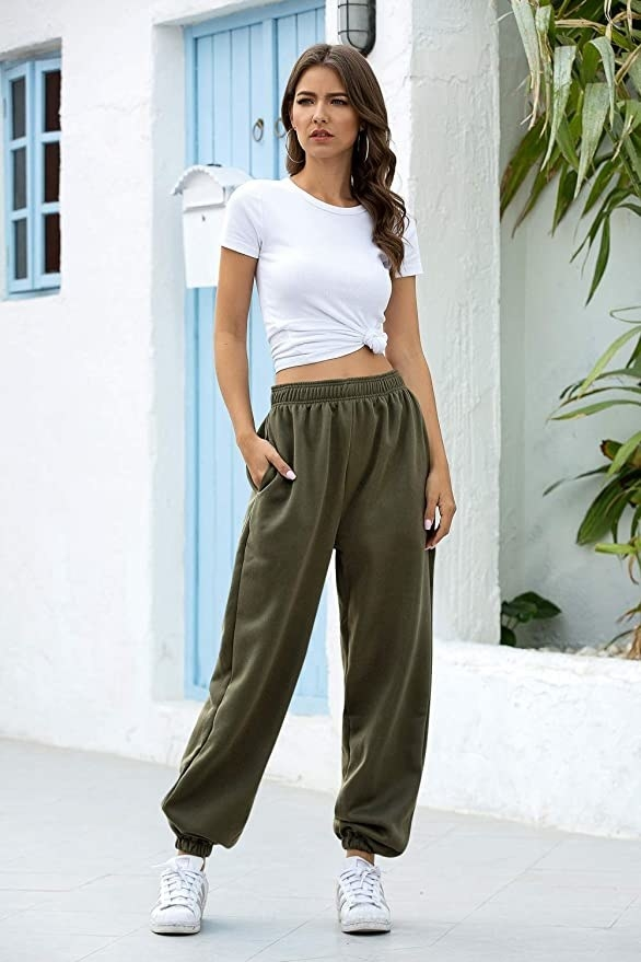 a model wearing the sweats in olive green
