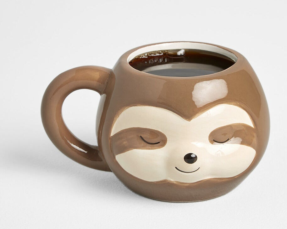 The mug, featuring a sleepy sloth face design