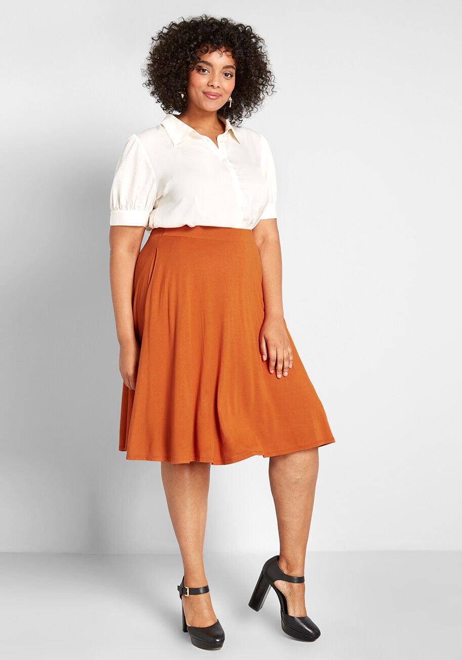Model wearing the skirt in burnt orange