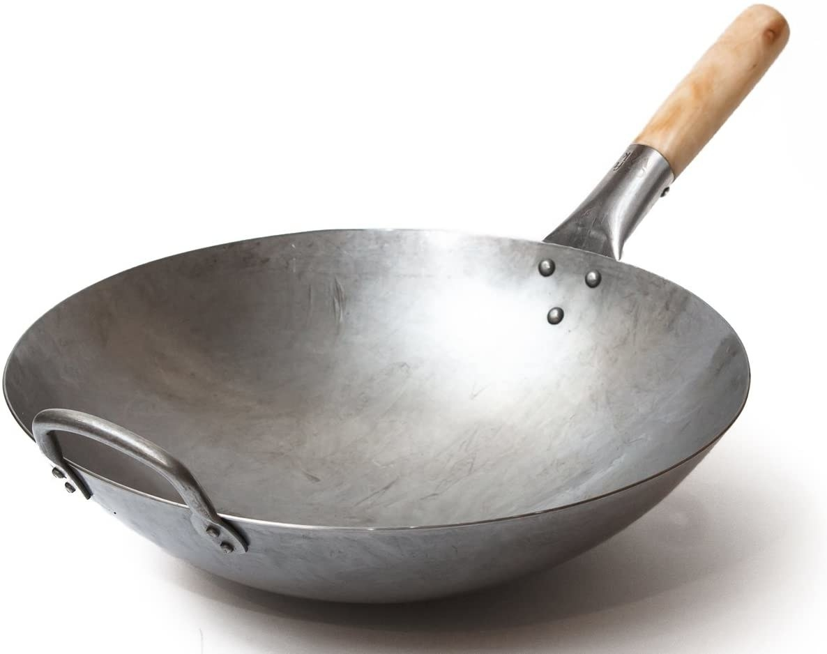 """The metal wok with wooden handle and metal """"helper"""" handle on the other side"""