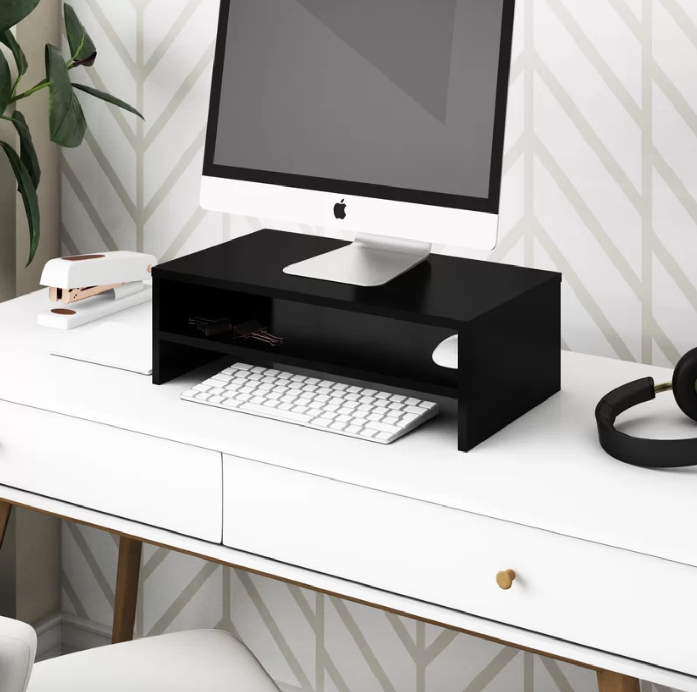 The monitor stand in black on a desk