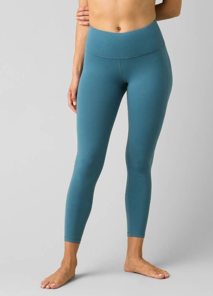 model in teal yoga pants