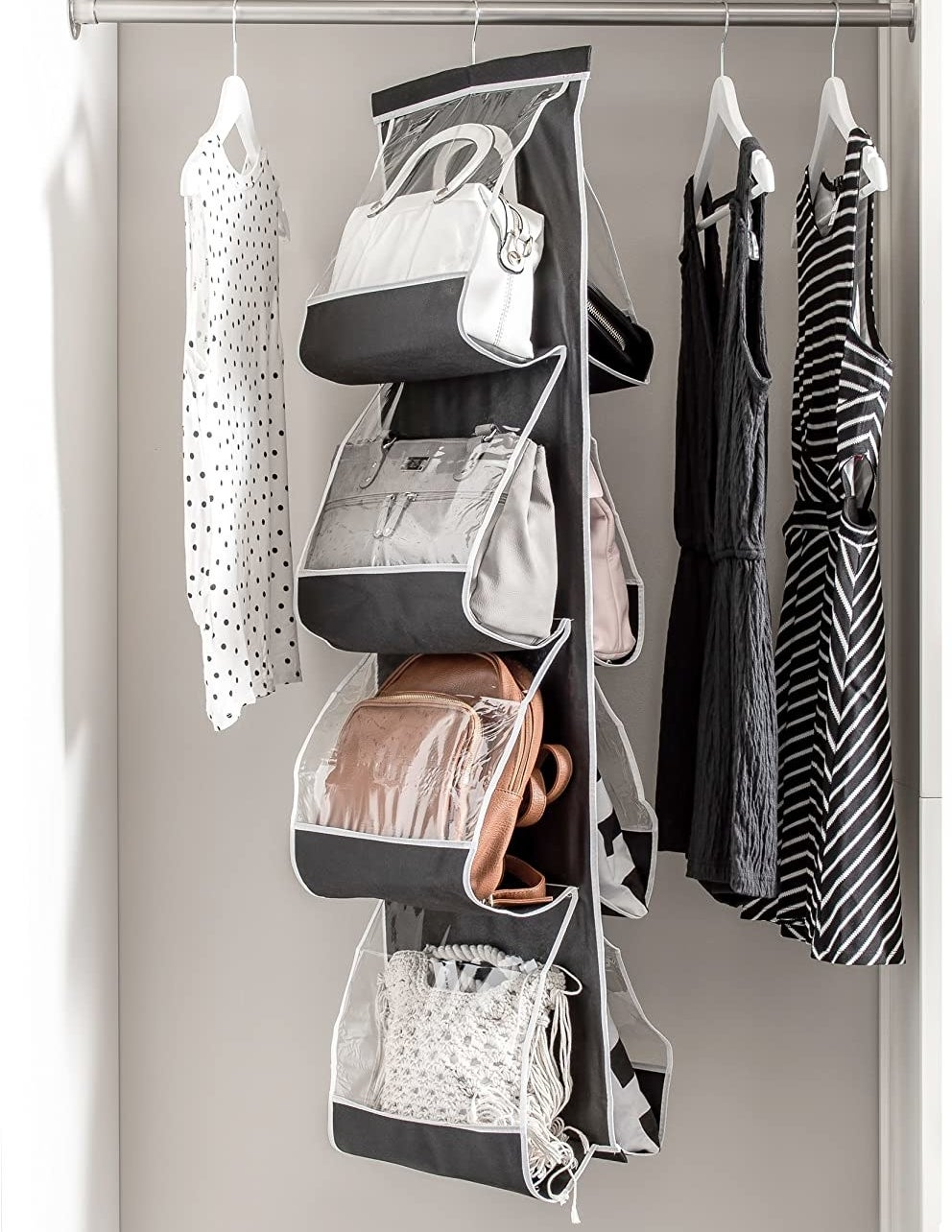The handbag holder in a closet with eight bags inside