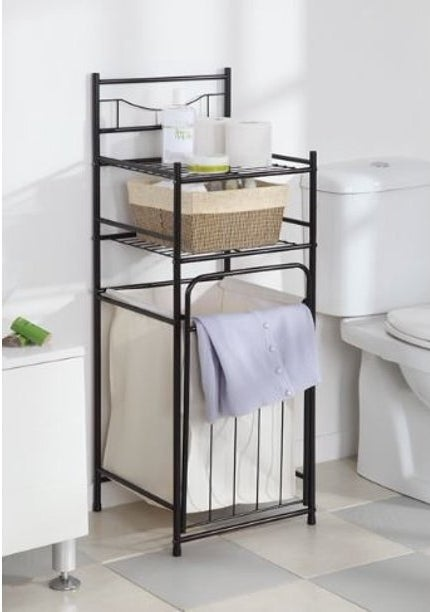 A black metal hamper with two shelves on top