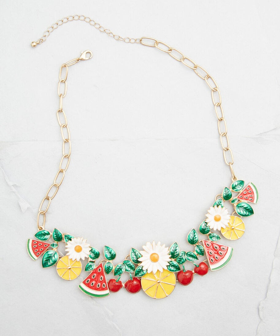 The necklace, featuring watermelon, cherries, lemons, and daisies