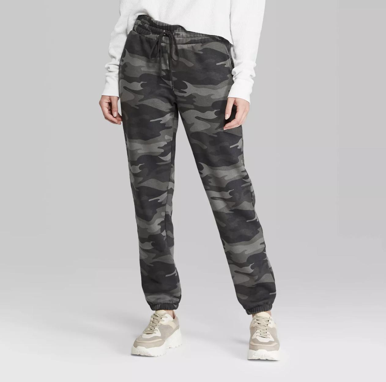 a model wearing grey camo sweatpants