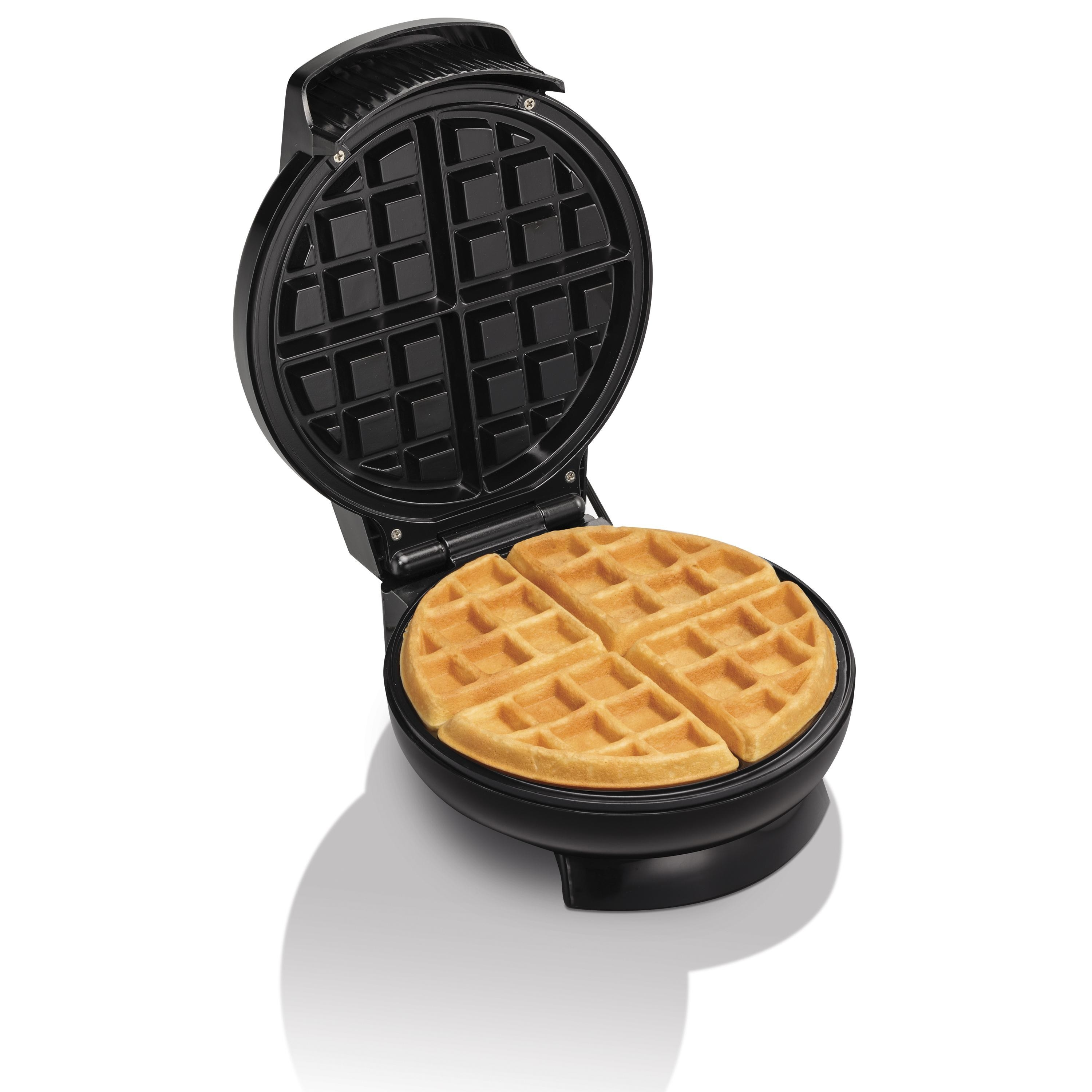 The waffle maker with a waffle in it