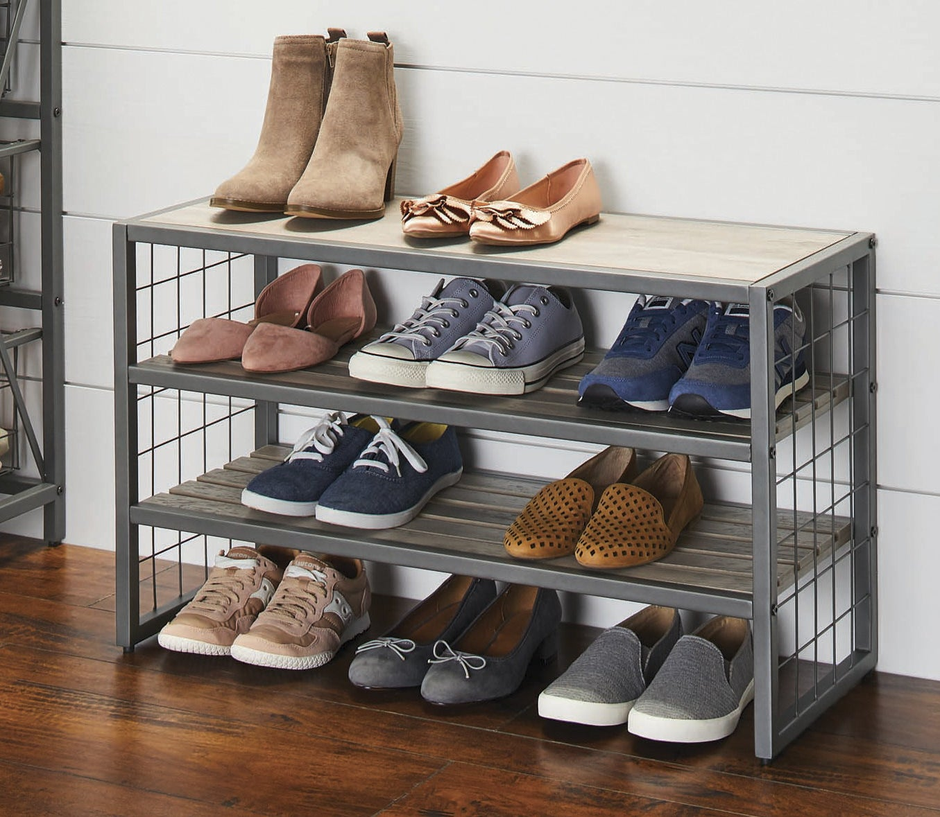 A four shelf shoe rack in gray wood