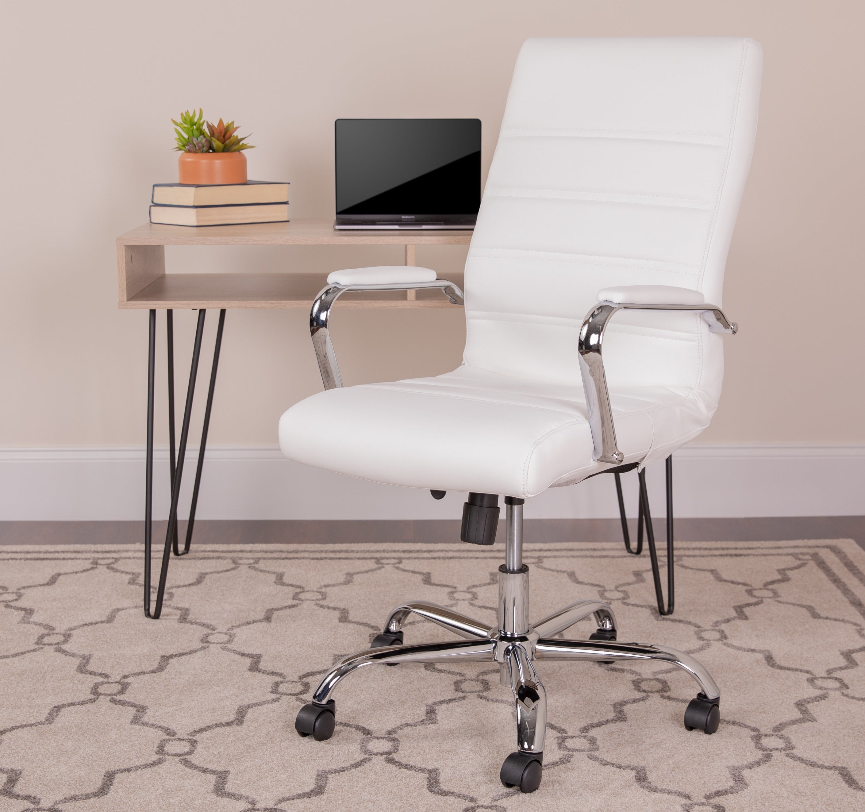 A white swivel chair