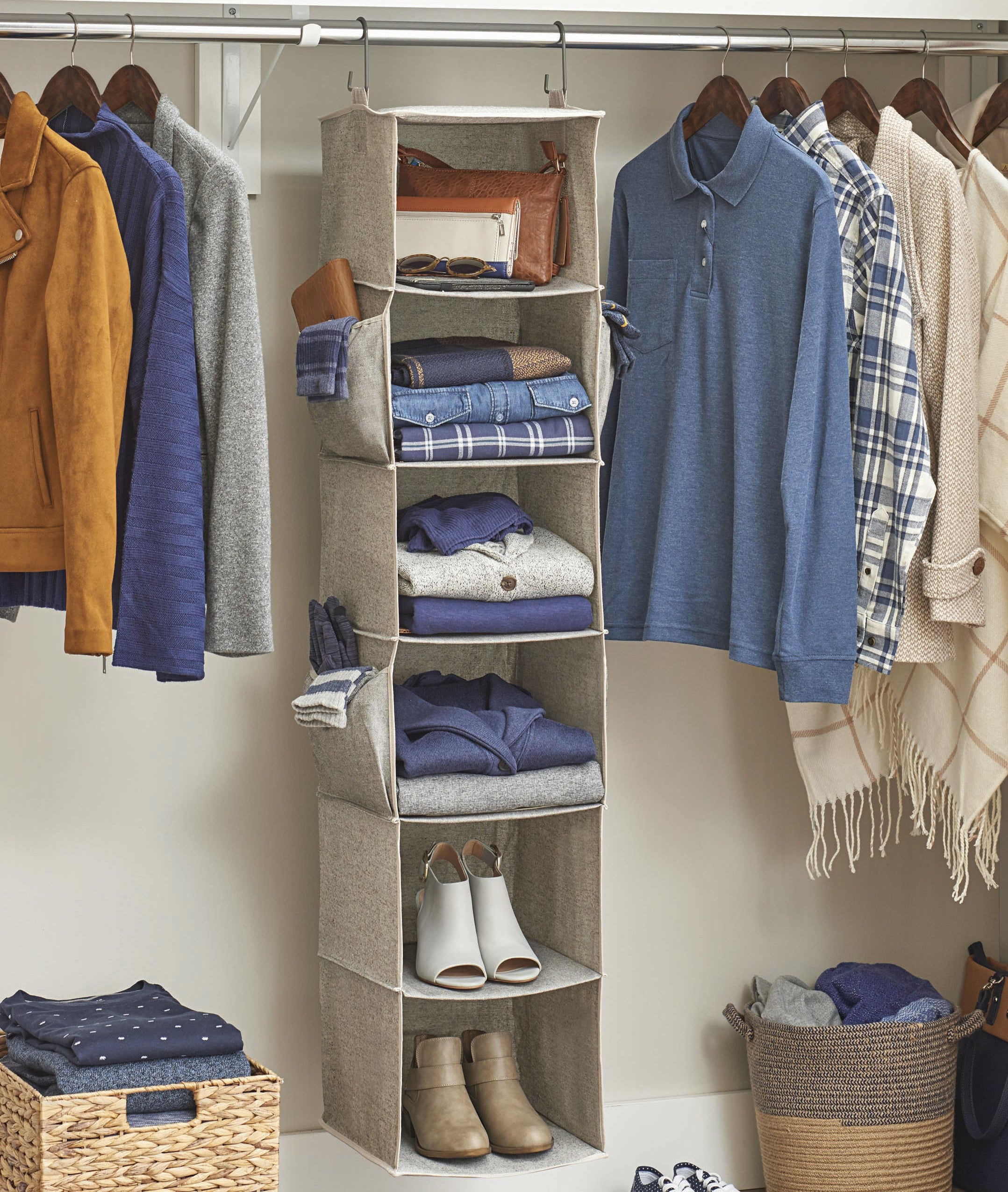 A beige hanging organizer shelf with six square slots
