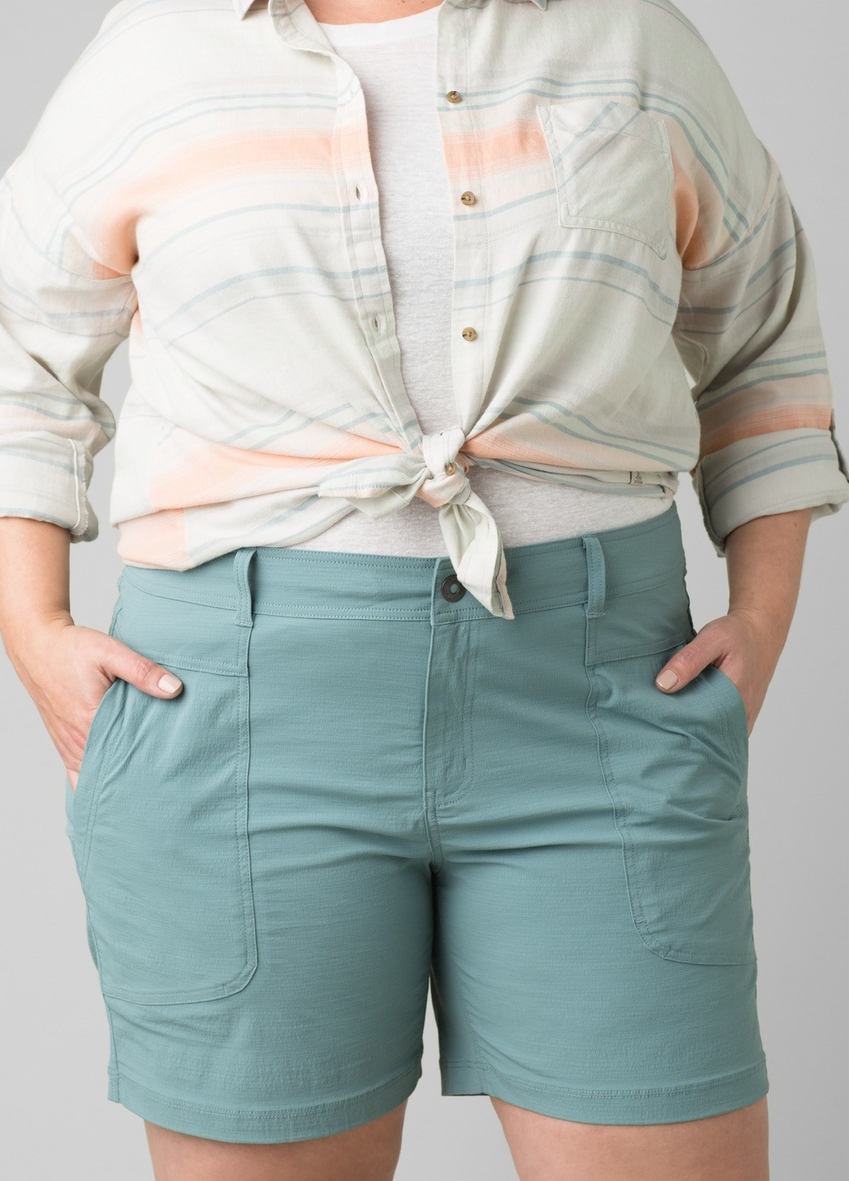 model in teal mid-thigh length shorts with large pockets