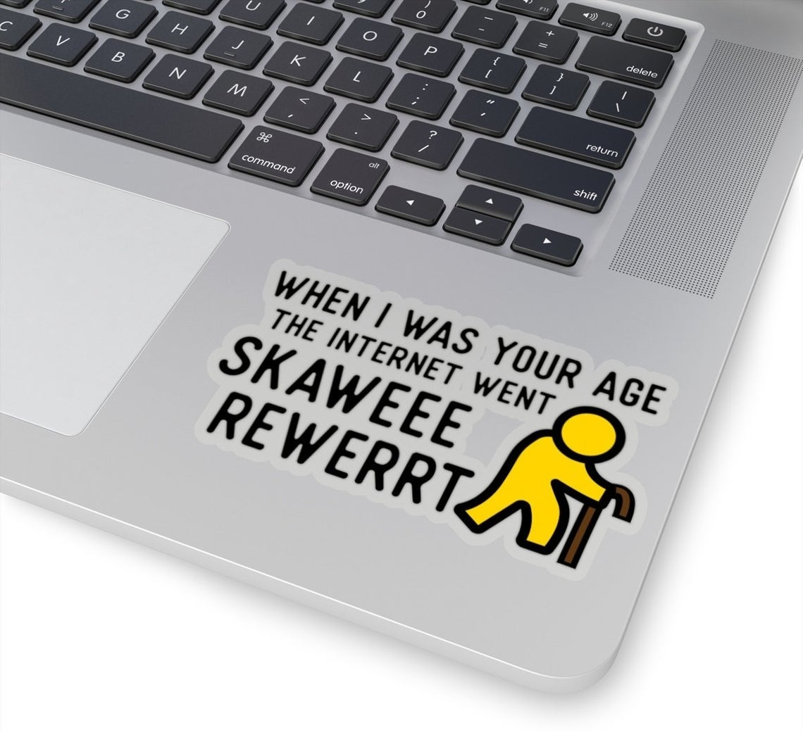 "The sticker, which reads ""When I was your age the internet went Skawee Rewerrt,"" placed on a laptop"