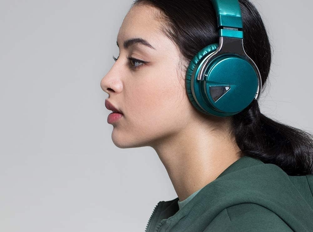 A person wears the headphones