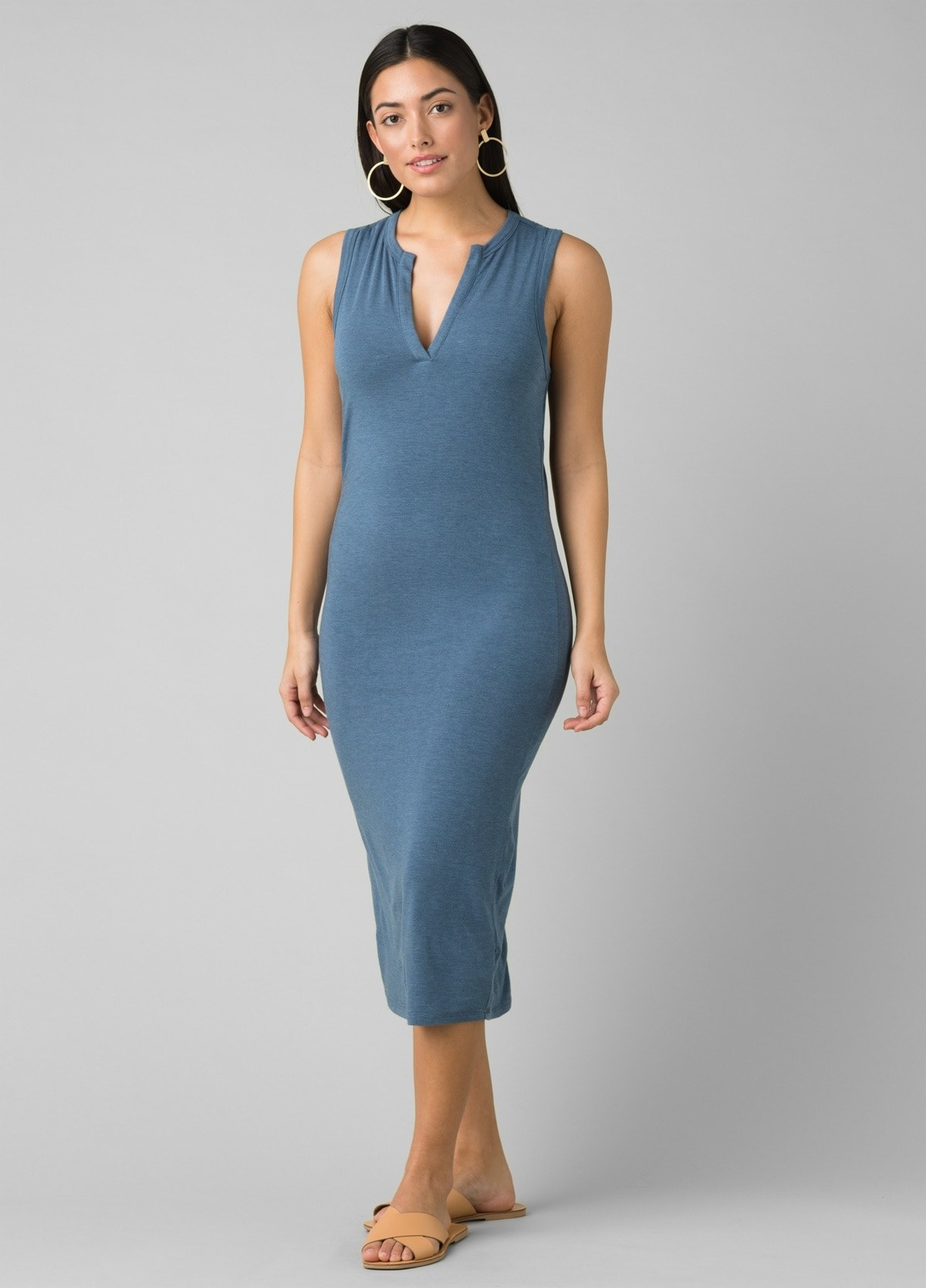 model in blue dress with wide tank sleeves