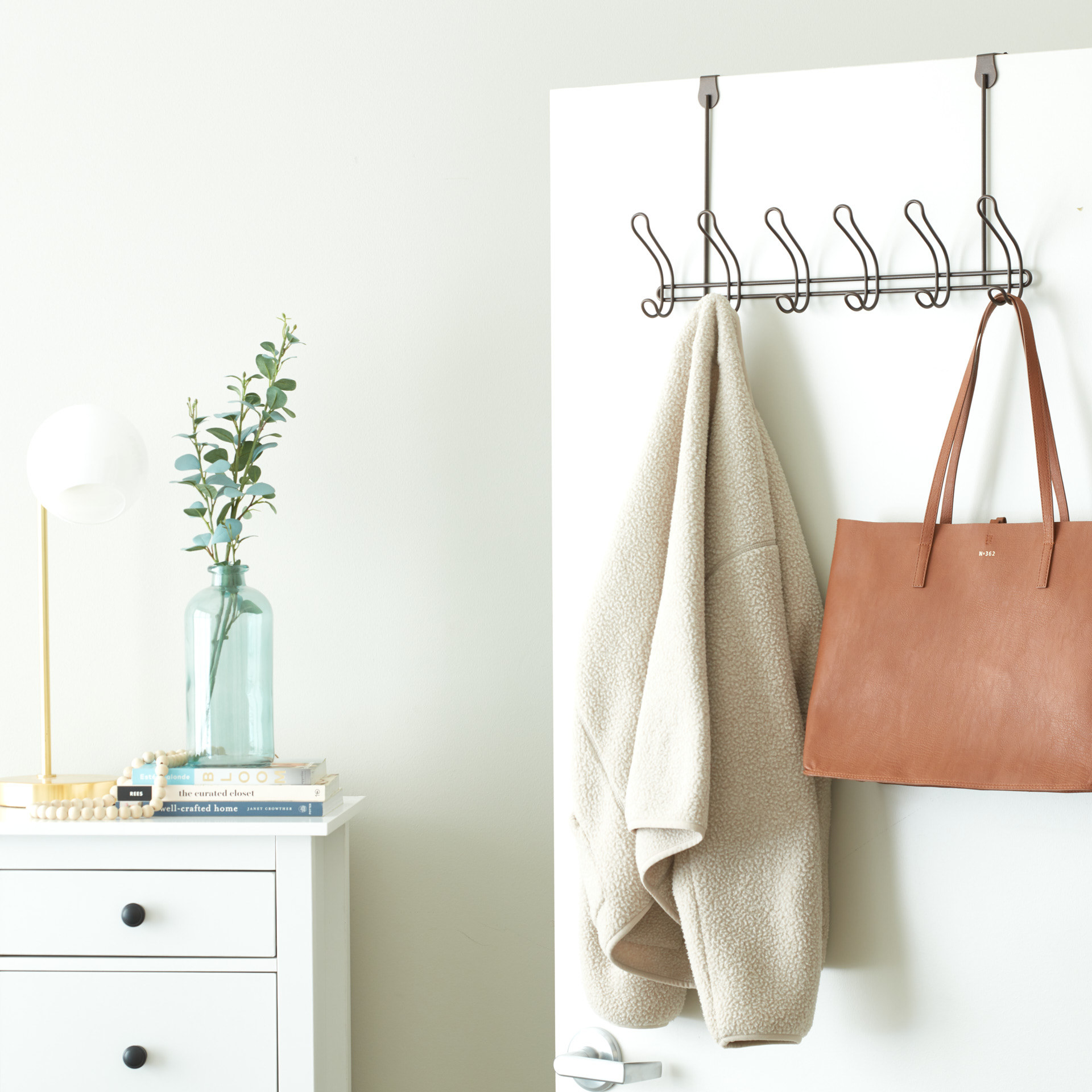 A metal over the door coat rack with six hooks