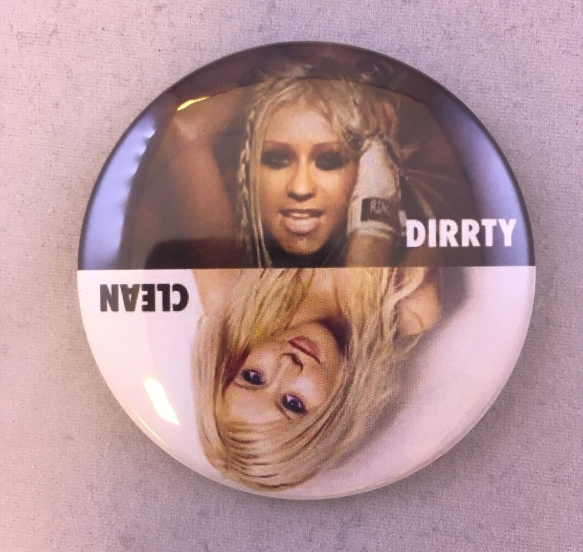 A round magnet with Christina Aguilera from the Dirrty music video on the top and from her Genie In The Bottle days on the bottom.