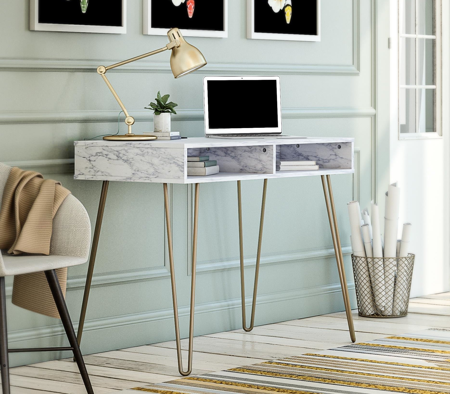 A white marble desk with gold hairpin legs
