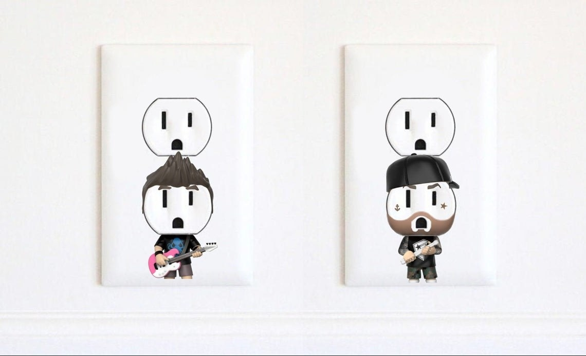 A set of outlet stickers designed to look like Travis Barker and Mark Hoppus from Blink 182.