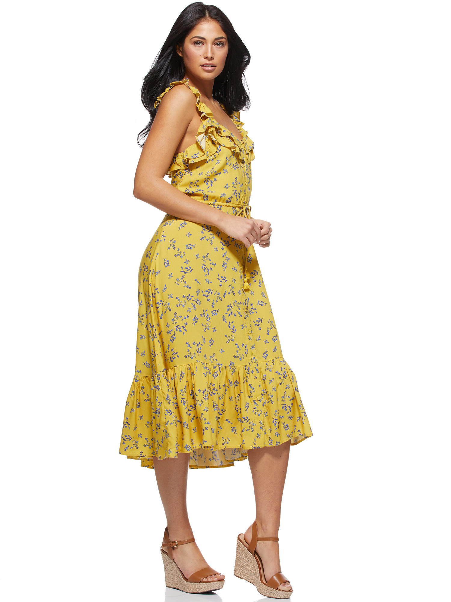 a model in the yellow dress with small florals on it