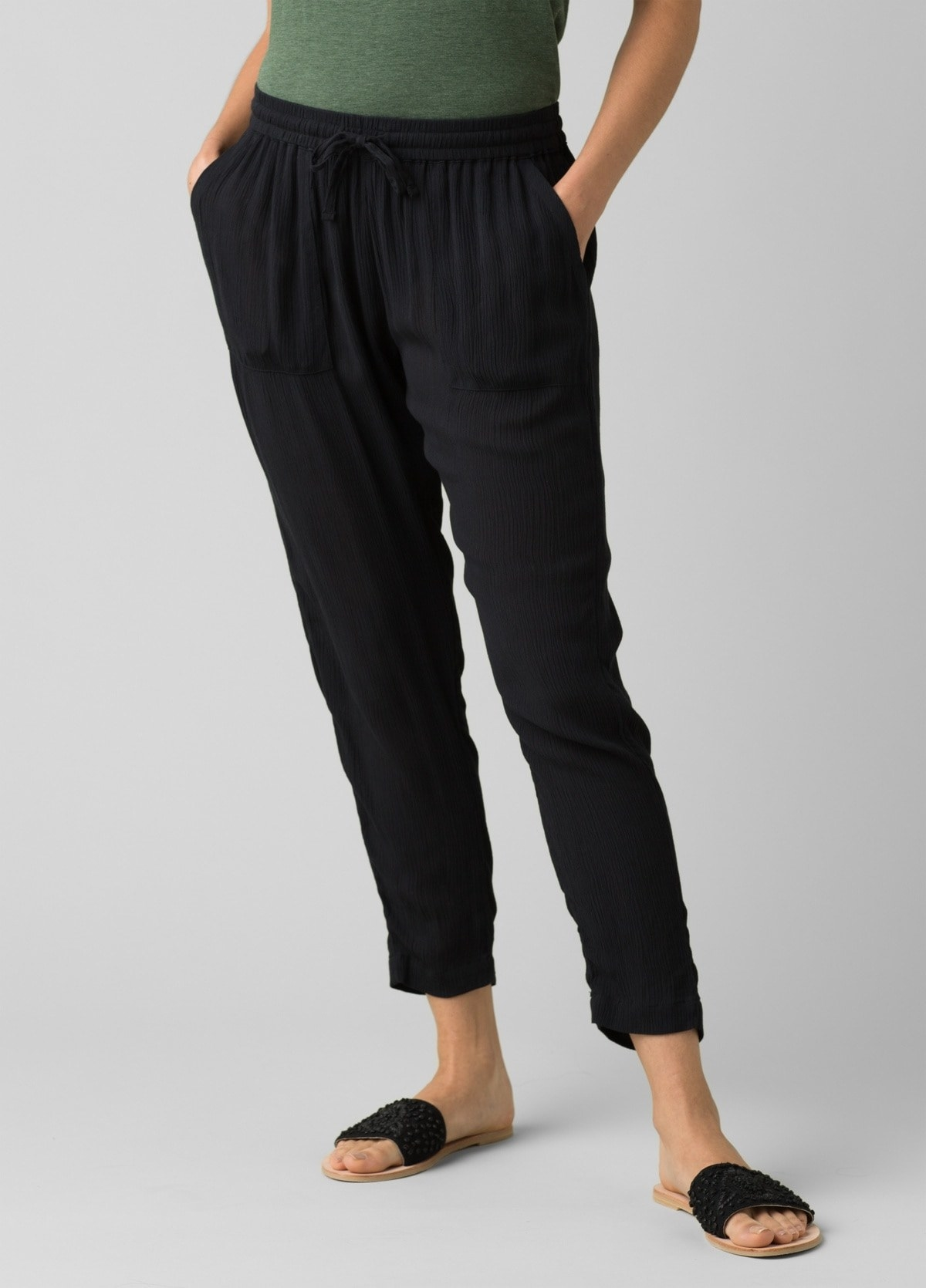 model in black ankle-length pants with drawstring