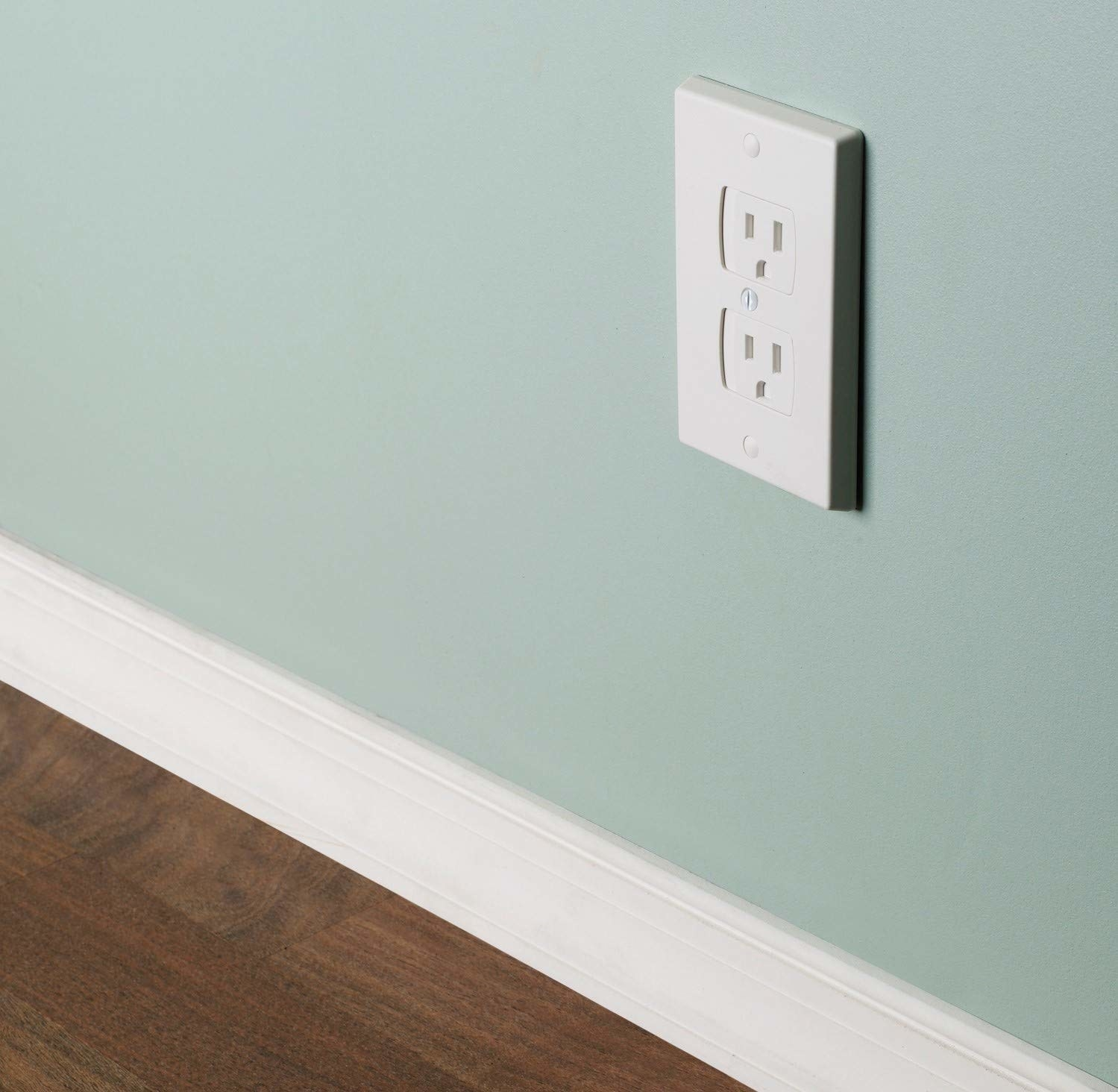 A white wall outlet with slide covers